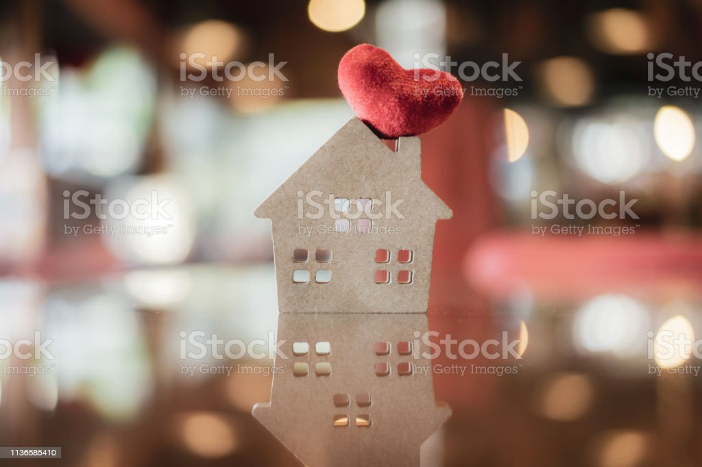House and heart model  on wood table , a symbol for construction , ecology, loan, mortgage, property or home. stock photo