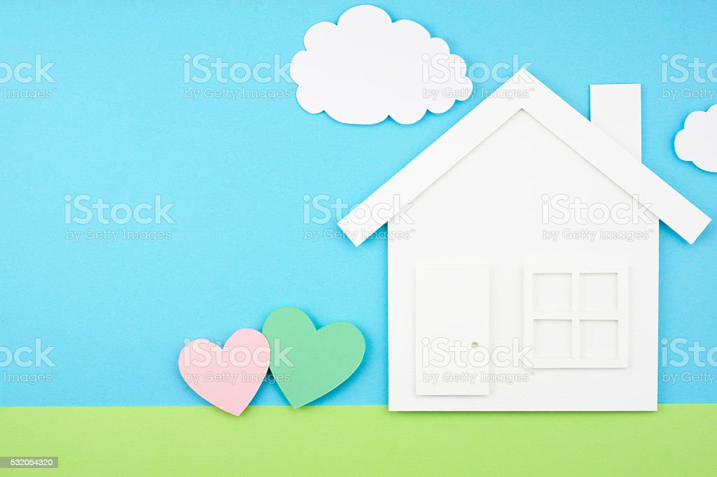 House and hearts on paper background. stock photo