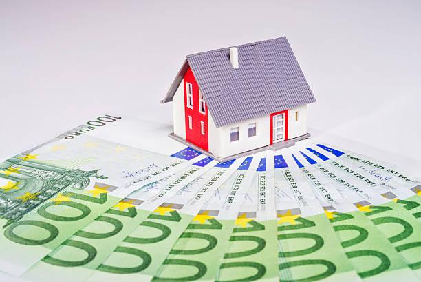 House and many bills stock photo