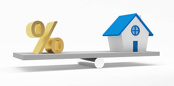 House and Percentage on the balance stock photo