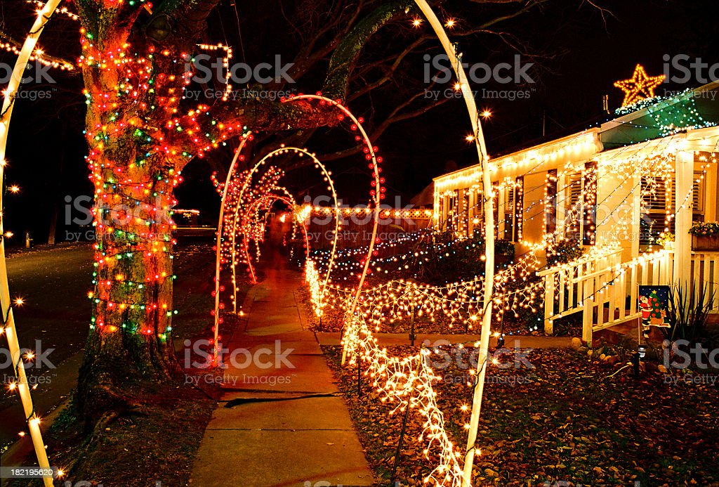 House and sidewalk decorated with Christmas lights royalty-free stock photo