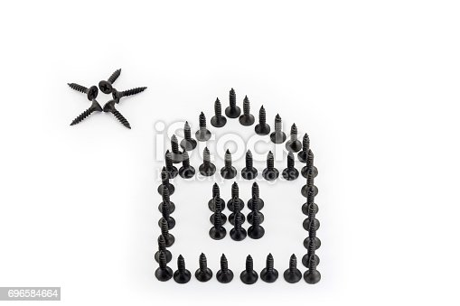 istock House and sun laid out with Phosphated black screw isolated on white background 696584664