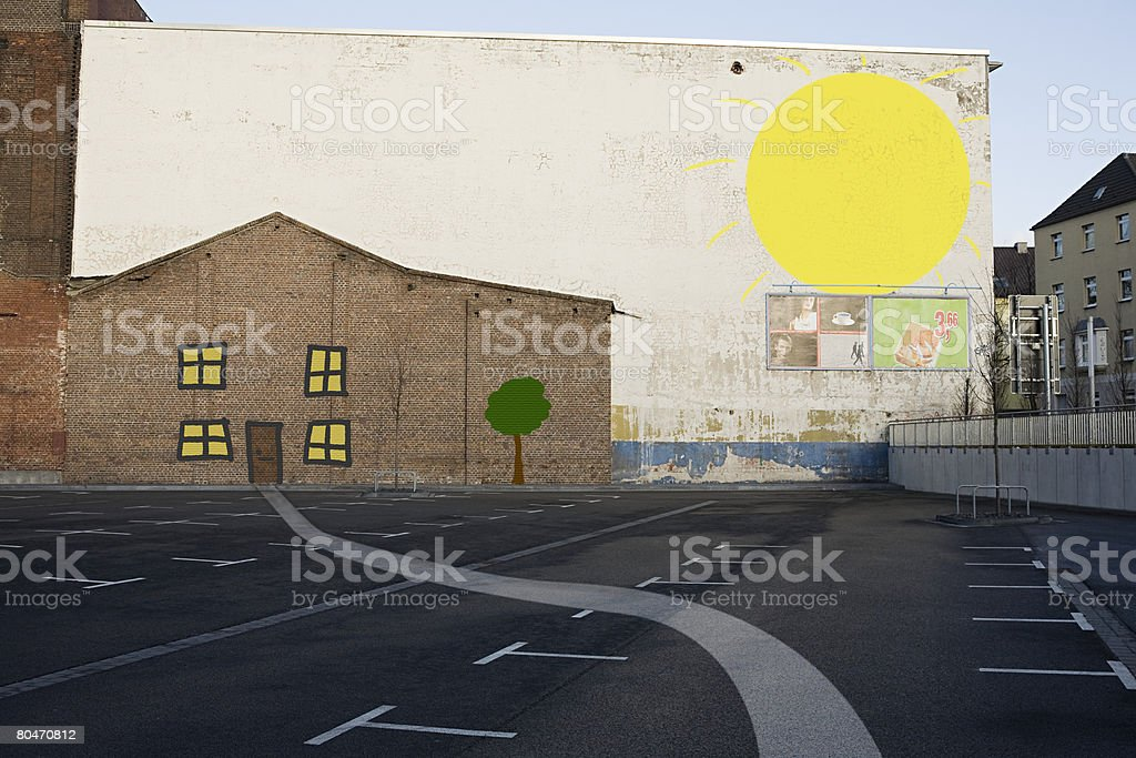 House and sun painted on wall 免版稅 stock photo