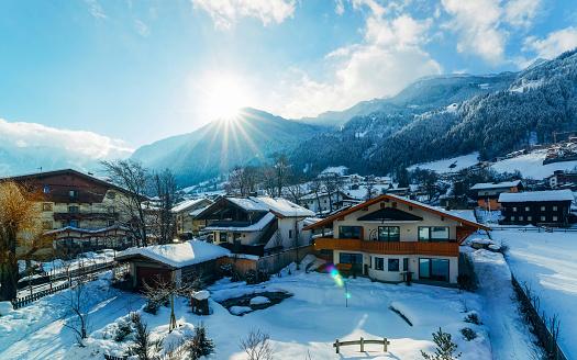 House architecture at Mayrhofen in Zillertal valley Tirol Austria sunny reflex