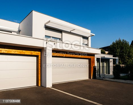 697393252 istock photo house architecture style with large garage automated door 1137008468