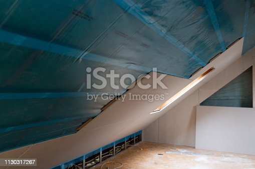 466705128 istock photo House attic insulation and renovation. Drywall construction 1130317267