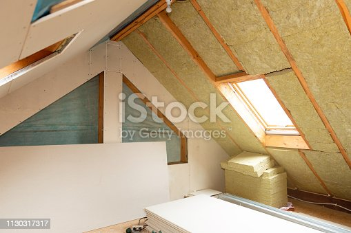 466705128 istock photo House attic insulation and renovation. Drywall construction 1130317317