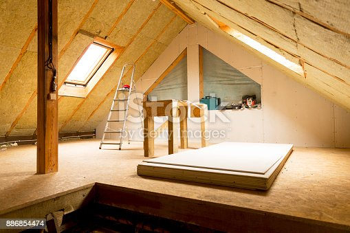 istock house attic under construction mansard wall insulation with rock wool 886854474