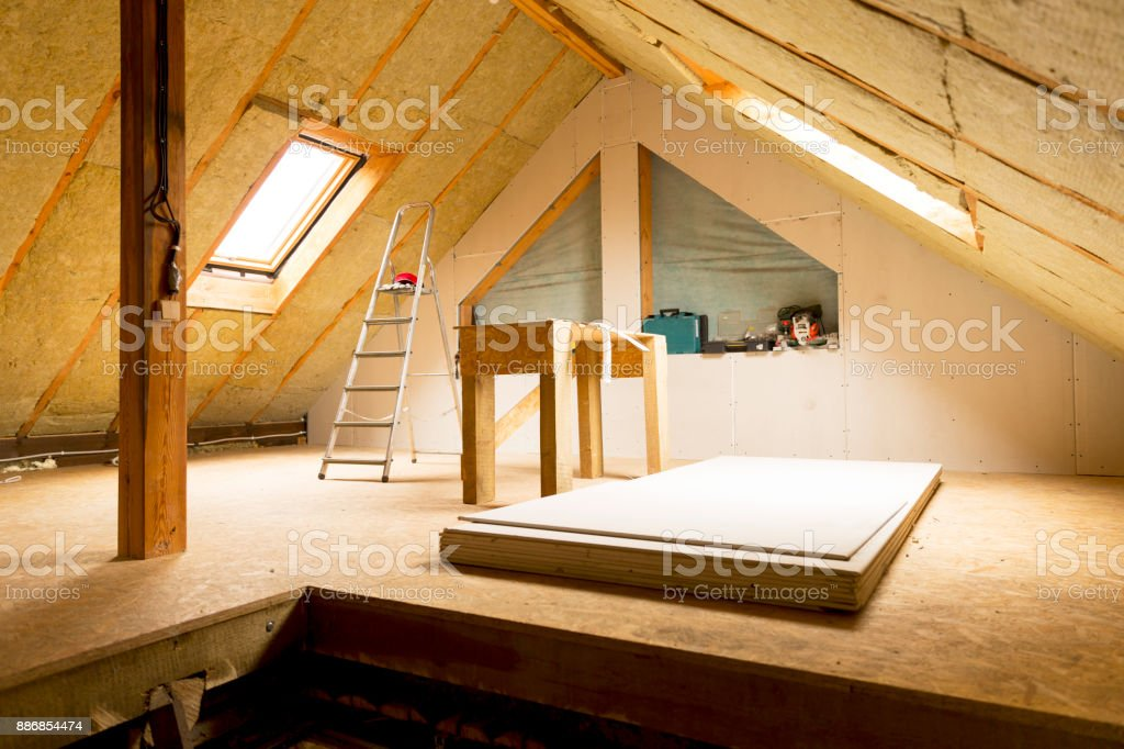 house attic under construction mansard wall insulation with rock wool stock photo