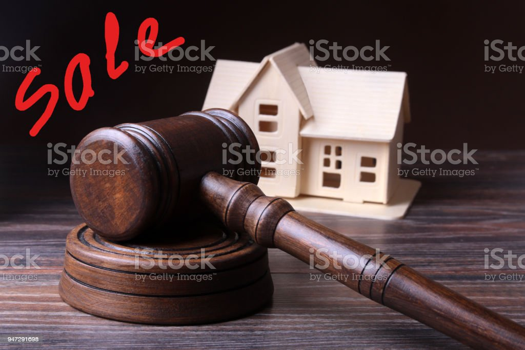 House Auction, auction hammer , symbol of authority and Miniature house . Courtroom concept. stock photo