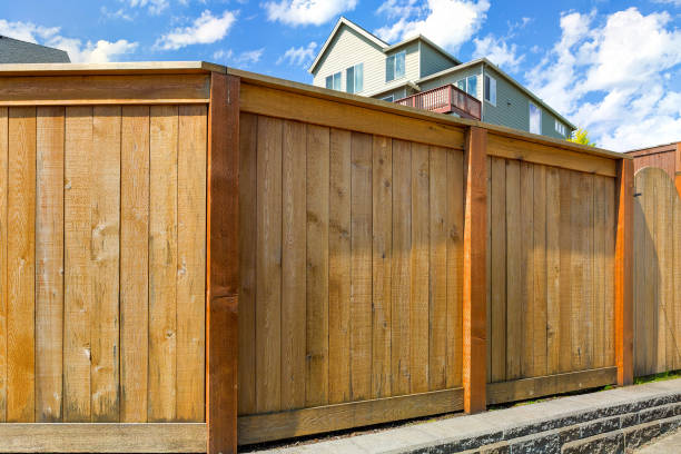 house backyard new wood fence with gate door in suburb - fence stock photos and pictures