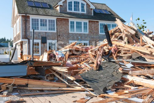 istock House being Demolished to make room for New 184945347