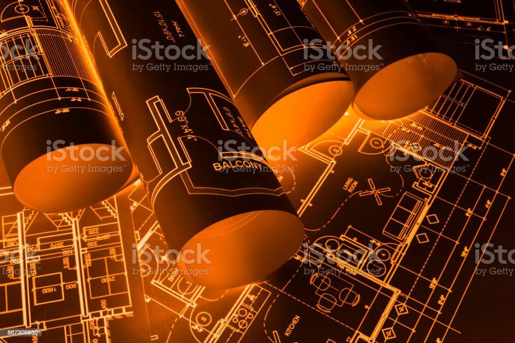 House blueprints, blue print style floor plans on architects desk,...