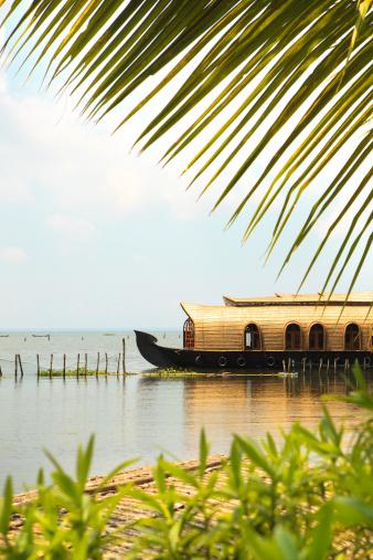 Traditional houseboat from the amazing Kumarakom Lake , Kerala, India.