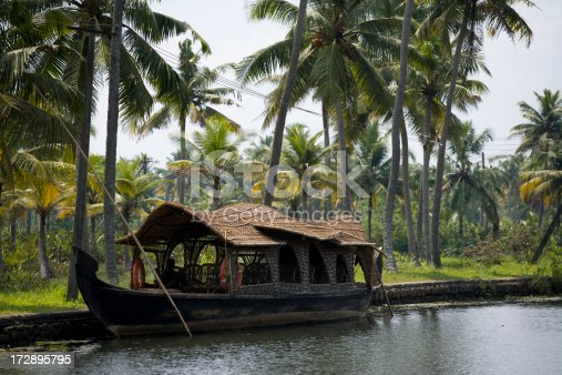 This is a moored house boat that is traditional to Kerala in South India.