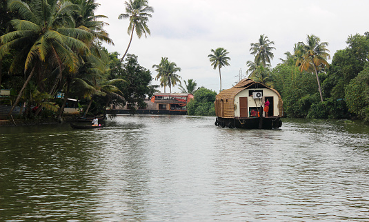 House boat sailing in the Allapuza backwaters, Kerala known as 'God's own country' is a famous tourist destination for its beaches,waterfalls,Ayurveda and tea estates.