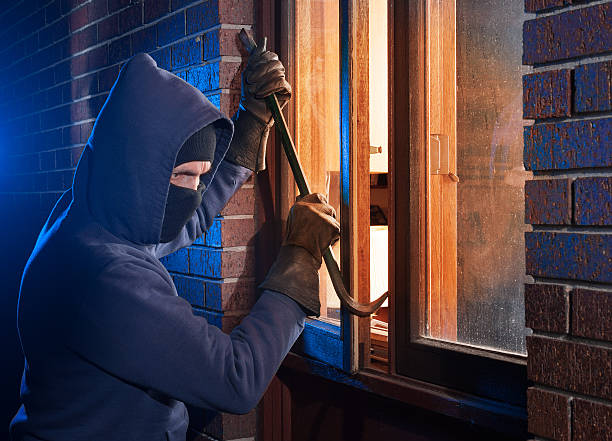 house break in by burglar - thief stock photos and pictures
