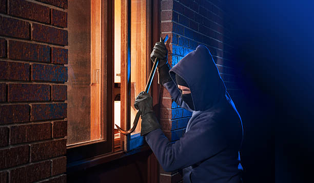 house break in - thief stock photos and pictures