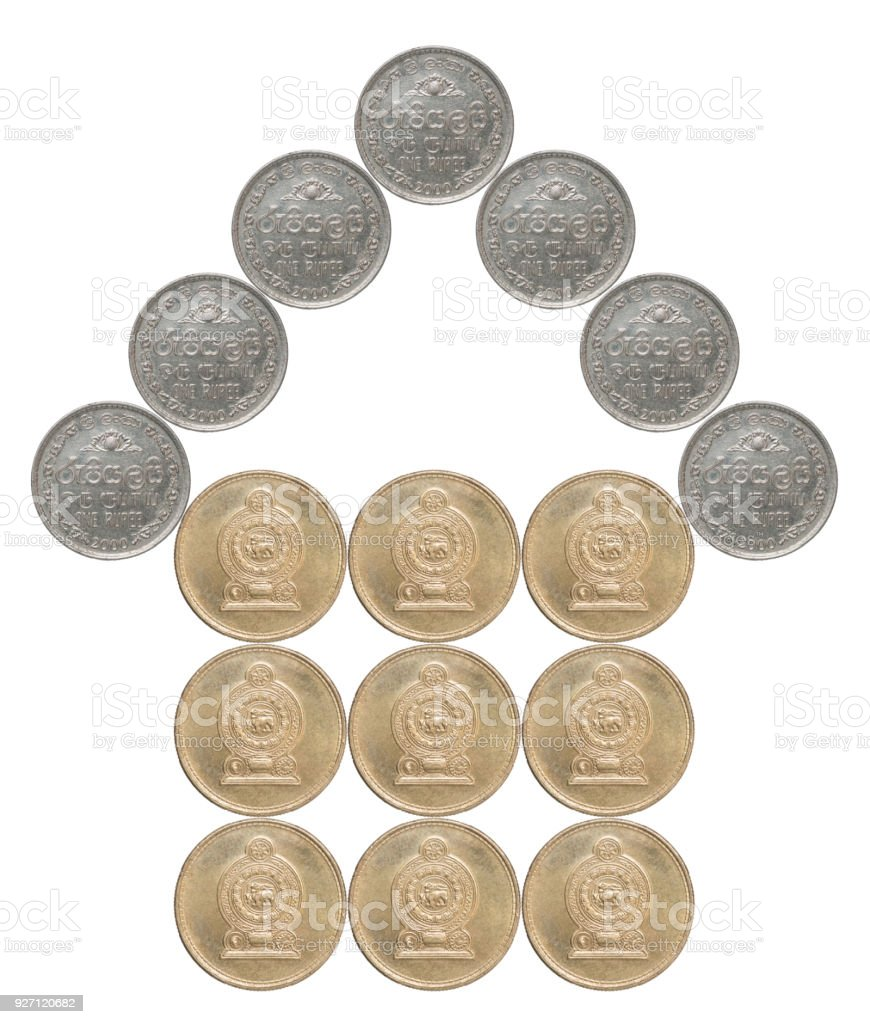 house built of coins stock photo