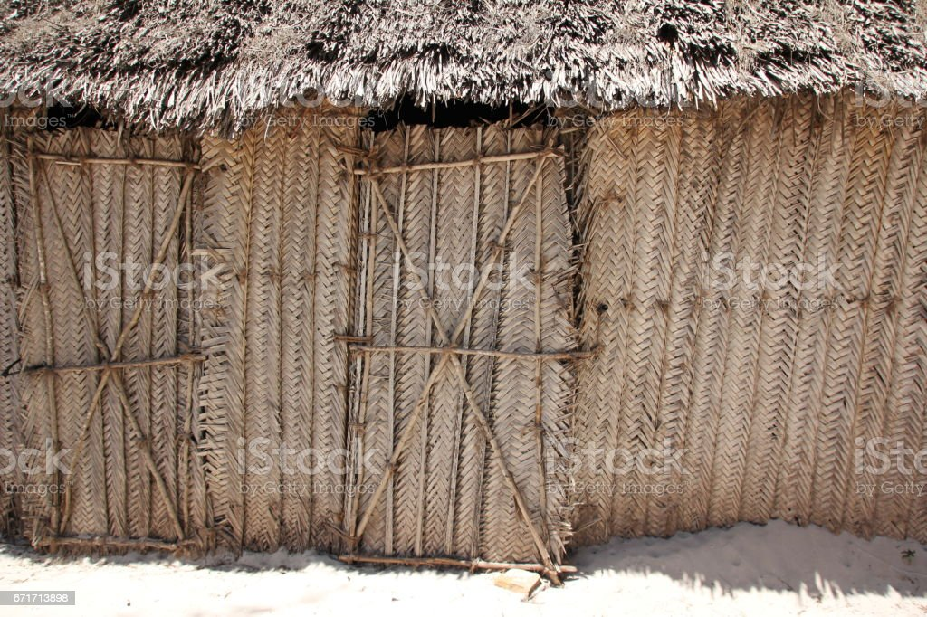 House built with handmade mats of woven plant leaves, Kiwengwa Beach, Zanzibar, Indian Ocean, Africa stock photo