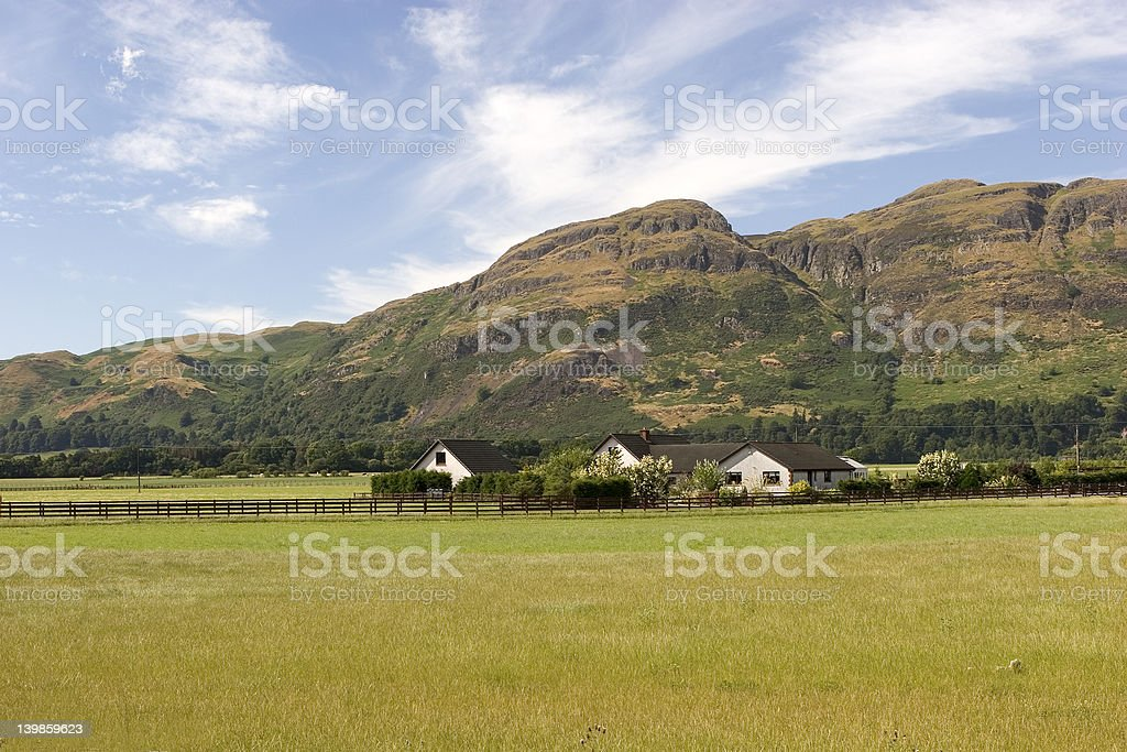 House by the hills royalty-free stock photo