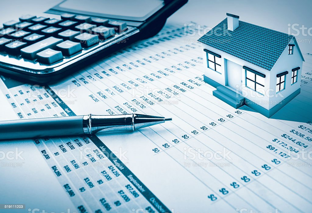 House calculation in pen, calculator and graph stock photo