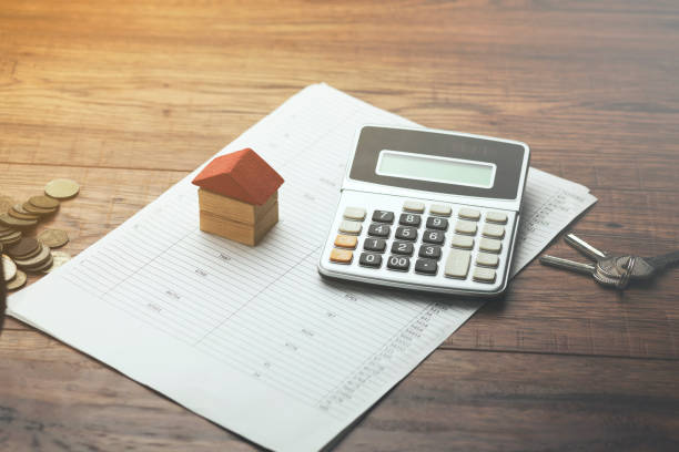 house calculator and key on document stock photo