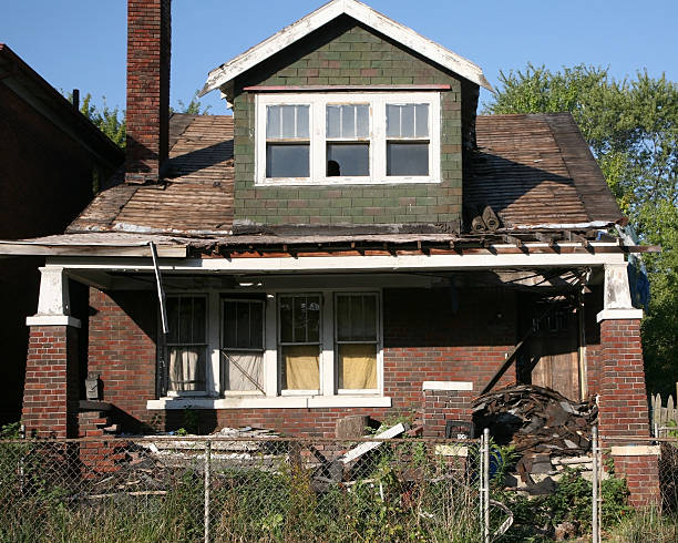 House caving in and rotting after being abandoned stock photo