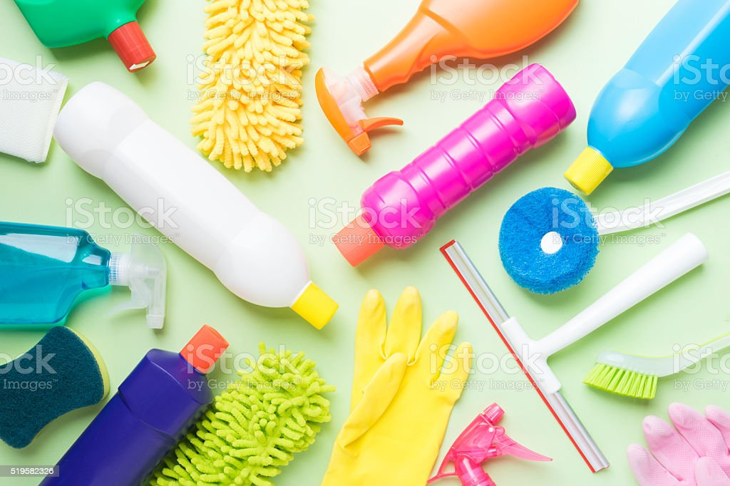 House cleaning product on green background stock photo