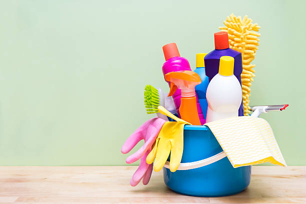 House cleaning product on wood table with green background House cleaning product on wood table with green background cleaning equipment stock pictures, royalty-free photos & images