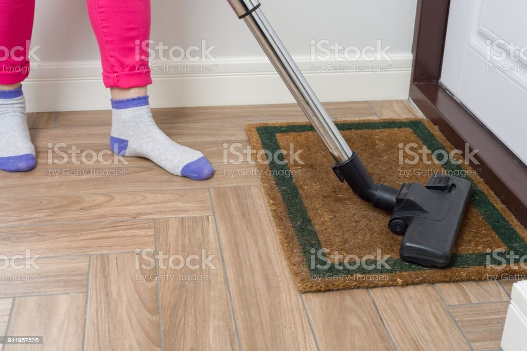 house cleaning woman is cleaning using vacuum cleaner royalty free stock photo
