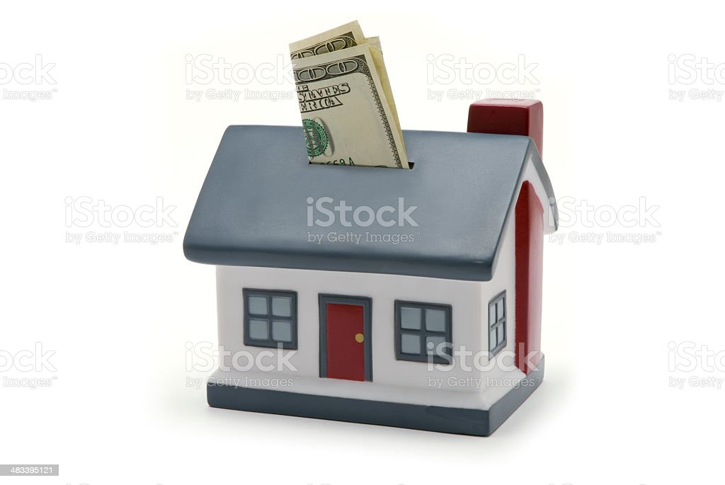 House Coin Bank with Money royalty-free stock photo