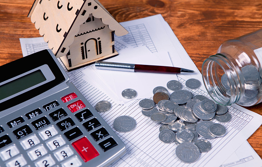 istock house, coins and calculator 1134417440