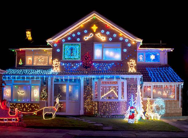 house colorfully decorated with bright christmas lights - christmas decoration bildbanksfoton och bilder