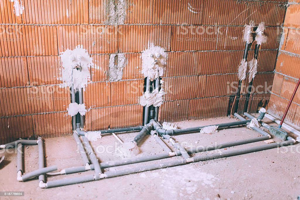 House construction and renovating, pipes and plumbing tools. stock photo