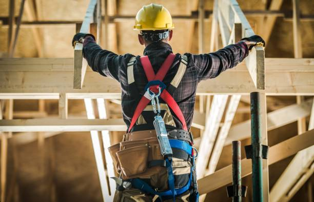 House Construction Challange Wood House Construction Challange. Caucasian Carpenter Contractor Wearing Safety Harness in Front of New Developed wood Frame Home. Construction Industry. safety harness stock pictures, royalty-free photos & images