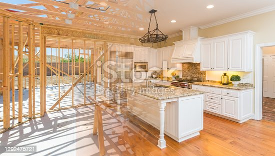 istock House Construction Framing Gradating Into Finished Kitchen Build 1292475721
