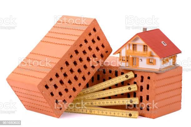 House construction with brick tools plan and model house picture id951680600?b=1&k=6&m=951680600&s=612x612&h=b2w0ld5s oiig8aiw5qu ahznlvjoixsmbr53dlwkcw=