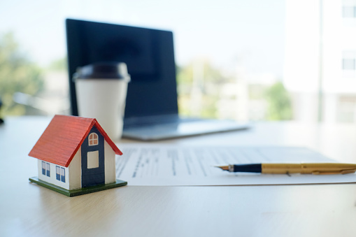 istock house contract Mortgage contract for sale of real estate property with a pen and house model. 950996994