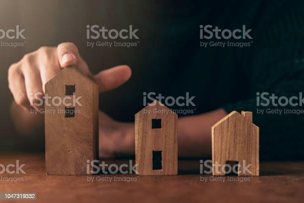 House design decision ideas concept with man hand pick house shape picture id1047319332?b=1&k=6&m=1047319332&s=612x612&h=qxxg7lsgufj5q t5ktgknqaib67z2grn5h9lsoz y8g=