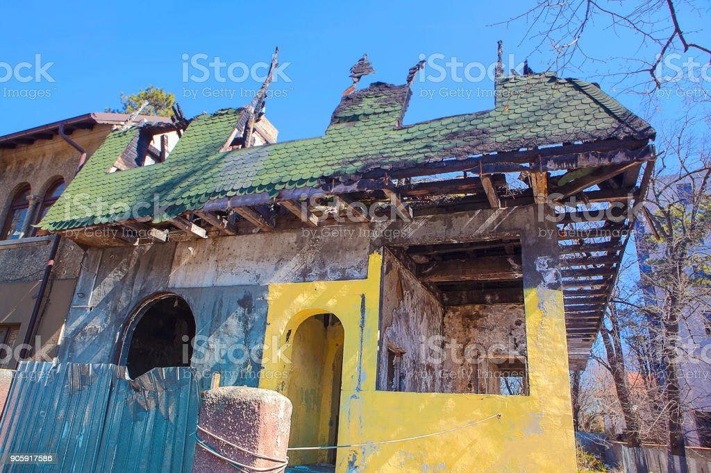 house destroyed by fire stock photo