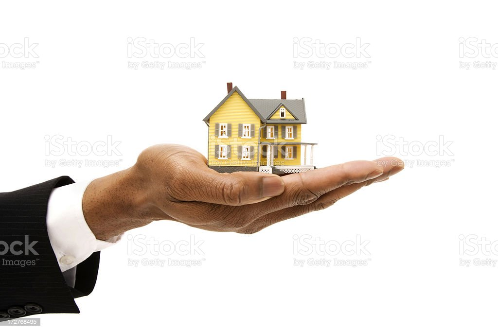 House displayed on a hand royalty-free stock photo