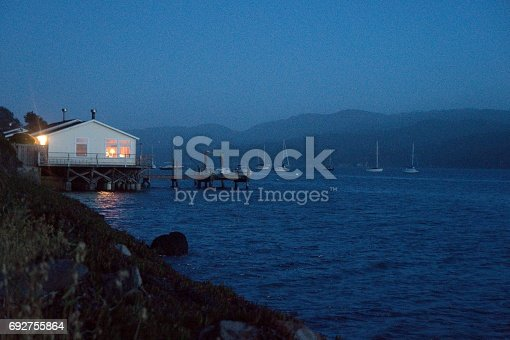 A nice view of a boat dock during the end of a sunset on tomales bay.