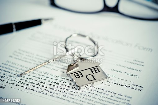 istock House document with keys and pen 498714252