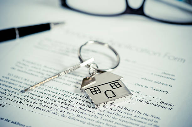 House document with keys and pen House document with keys and pen real estate sign stock pictures, royalty-free photos & images