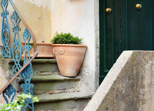 house entrance and terracotta vase stock photo