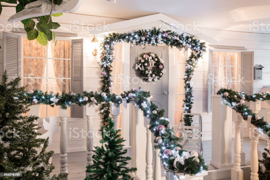 house entrance decorated for holidays. Christmas decoration. garland...