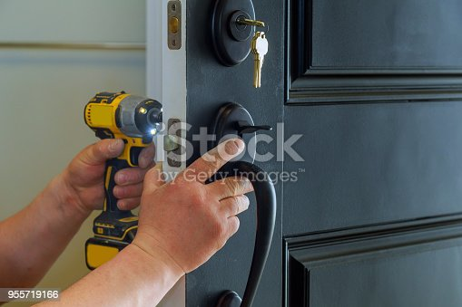 istock house exterior door with the inside internal parts of the lock visible of a professional locksmith installing or repairing a new deadbolt lock 955719166