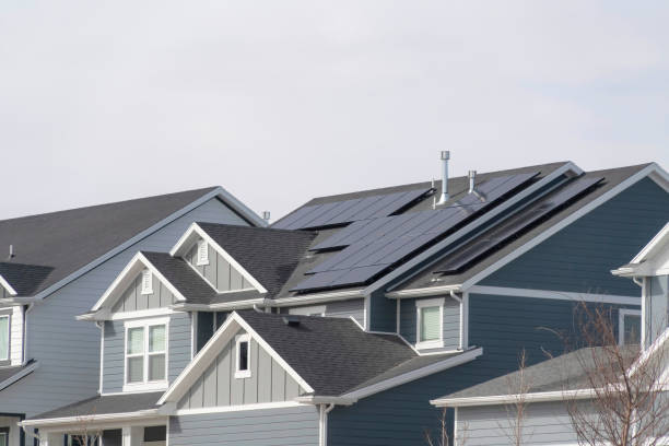 House exterior in South Jordan Utah with view of solar panels on the gray roof stock photo