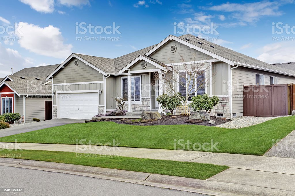 House exterior. View of entrance porch with walkway and garage stock photo